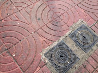 Utility covers and sidewalk tiles, StreetArt, Marseille, France 2014