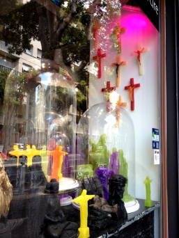 Religious candy colored knick knacks window display Marseille France ChrisCarterArtist 062814